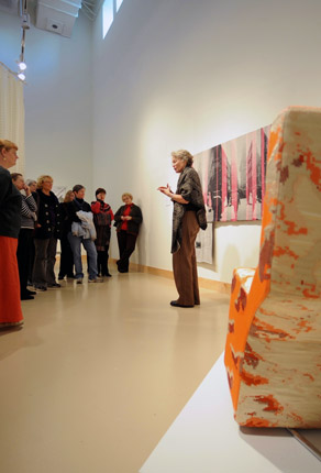 woman speaking in front of an art piece in the Fine art museum collection